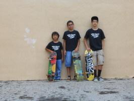 Jose Castillo, Juan Mercado, Anthony Azcuy with skateboards, New Skool Skate Team skaters