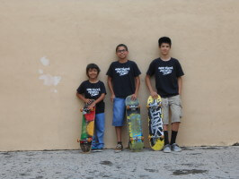 Jose Castillo, Juan Mercado, Anthony Azcuy with skateboards, New Skool Skate Team skaters