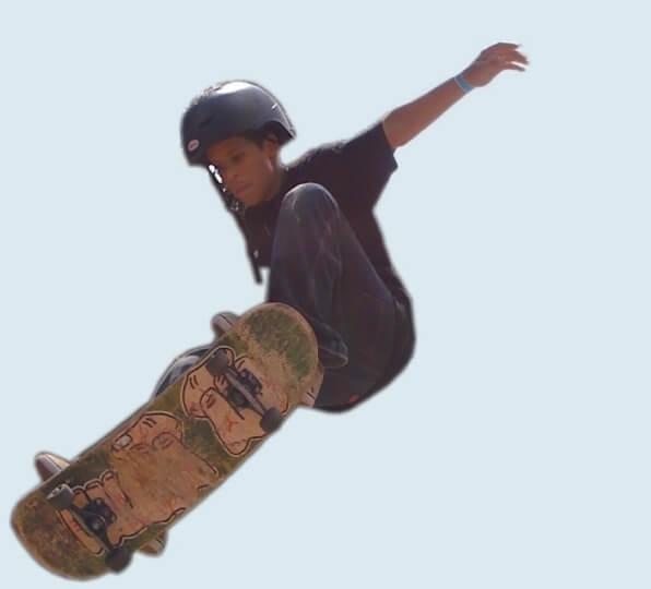 Anthony Azcuy ollie on ramp, skater for New Skool Skate Team