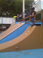 Jose Castillo on skate ramp getting ready to drop in at Coconut Grove Skatepark in FL. July 12, 2010