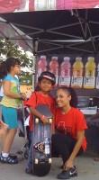 Jose Castillo gets Vitamin skateboard prize from Vitamin Water Girl, July 9, 2011 Westwind Lakes Skatepark Miami
