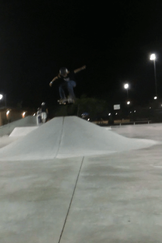 Skater Juan Mercado ollies high over Westwind Lakes Skatepark