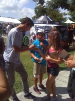 David Loy, Birdhouse Skater, signs autograph on Anabella Azcuy's phone, NYC TO MIA Tour 2011, Miami, Florida, Westwind Lakes Skatepark
