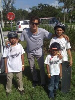 David Loy poses for a picture with Anthony, Jose, and Juan of New Skool Sports Skate Team at Westwind Skatepark, August 21, 2011